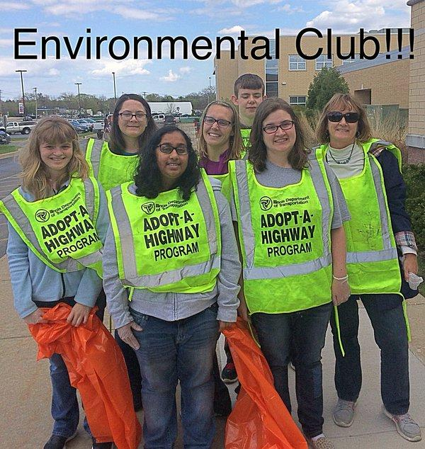 Grant Community High School's Environmental Club group photo wearing Adopt-A-Highway Program vests