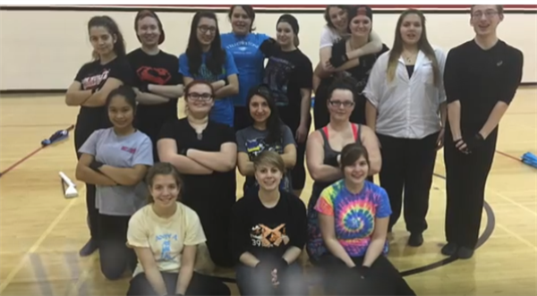 Grant Community High School's Winterguard group photo in gymnasium