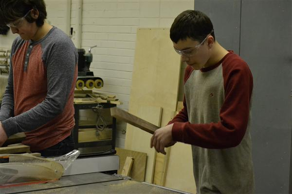 Grant Community High School's Woodworking Club image of student working with wood